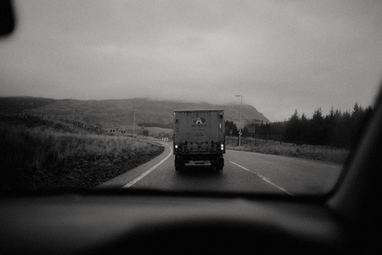 looking through a car window at truck on route to glencoe engagement