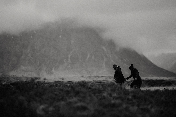 couple hold hands walking in glencoe during glencoe engagement