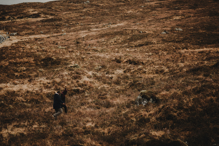 couple hike through glencoe during glencoe engagement