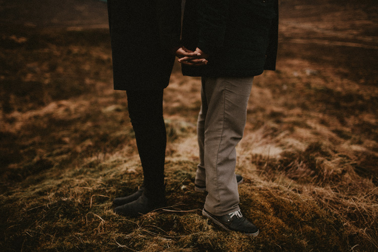 couple hold hands during glencoe engagement