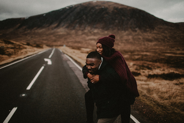 man gives fiance ride on his shoulders during glencoe engagment