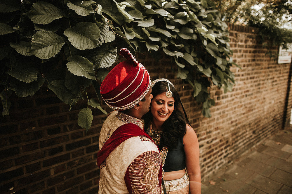 indian couple share a laugh during hindu wedding