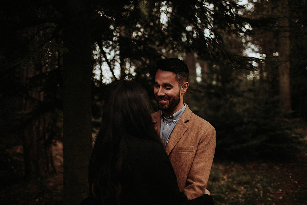 couple share laugh during London engagement session