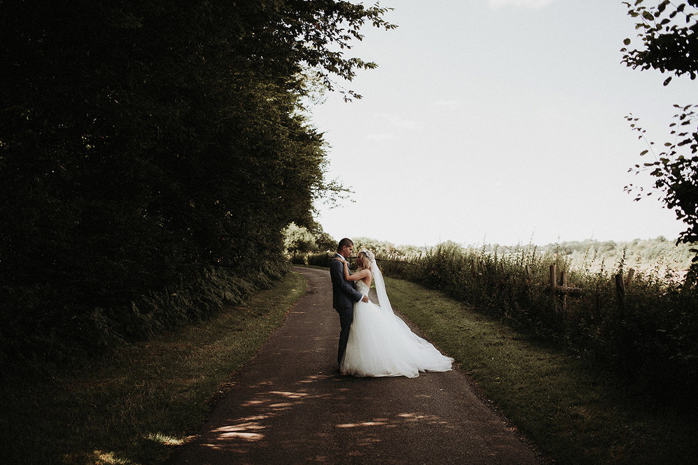 couple hold each other during intimate moment in Buckinghamshire wedding