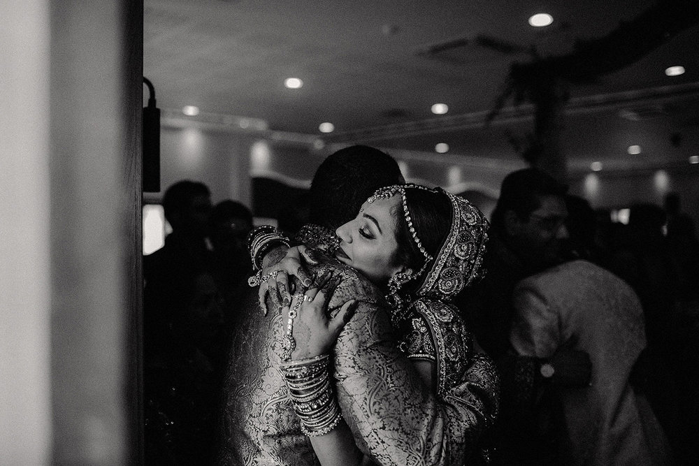 Copy of asian bride hugs brother after London hindu ceremony