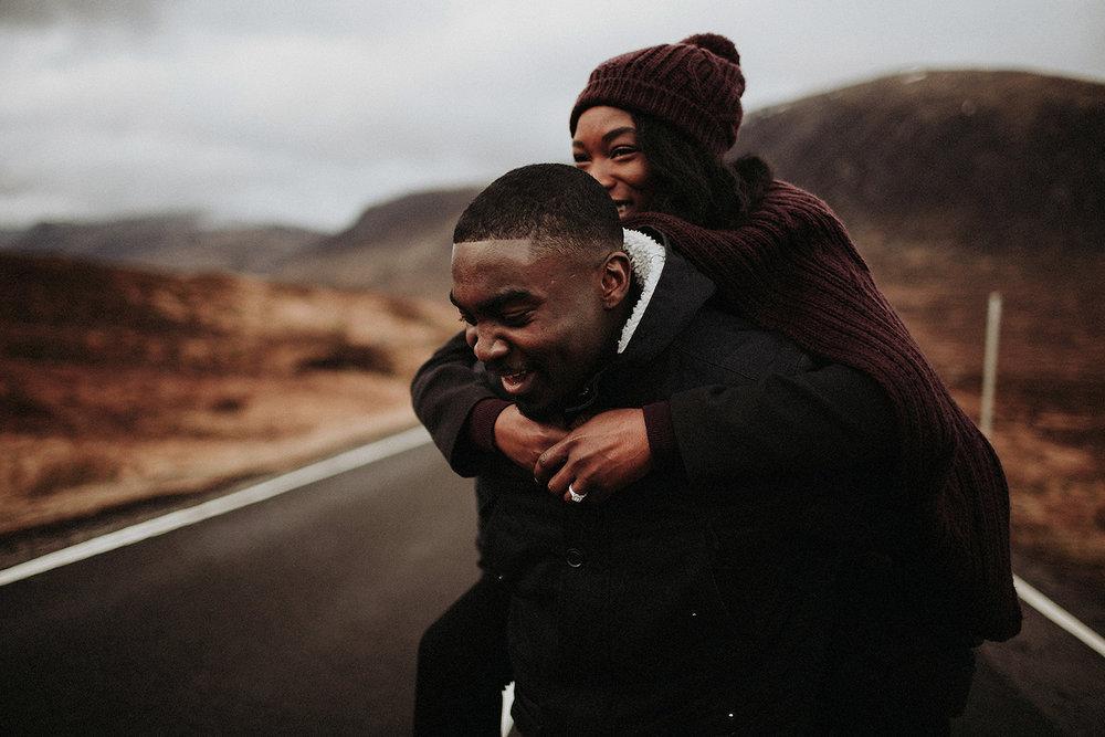 man piggybacks fiance in glencoe engagement