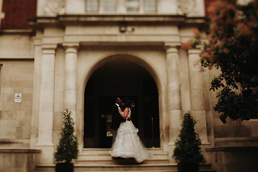 groom kisses bride on forehead in London hindu wedding