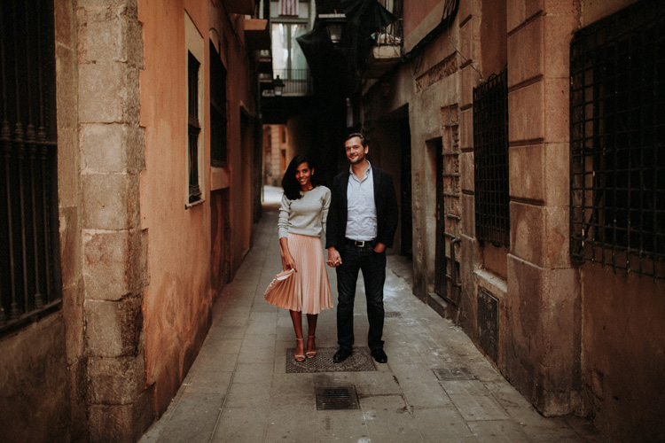 couple holding hands in the streets of the gothic quarter in Barcelona