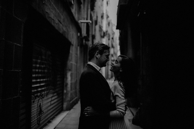 couple share intimate moment in the streets of the gothic quarter in Barcelona
