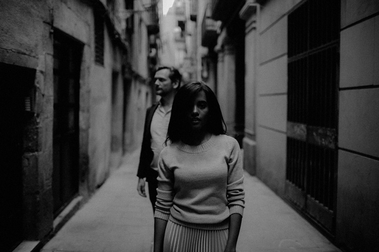 Couple stand in the streets of the gothic quarter in Barcelona