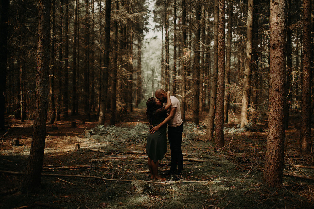 engaged couple sharing intimate moment in the Black Forest