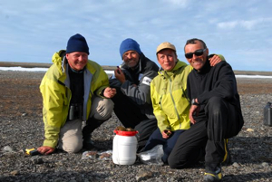 From left to right: Dr. Olivier Gilg, Luc Hardy, Brigitte Sabard and François 'Ben' Bernard around the Arctic poppy.