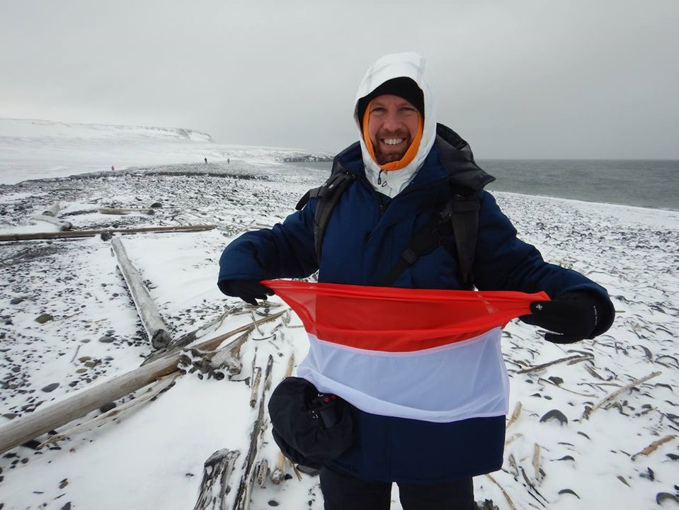 Adrien de Bontin with the Monaco flag on Bennett Island. Thank you to the Prince Albert II of Monaco Foundation for its support of this expedition    www.fpa2.org