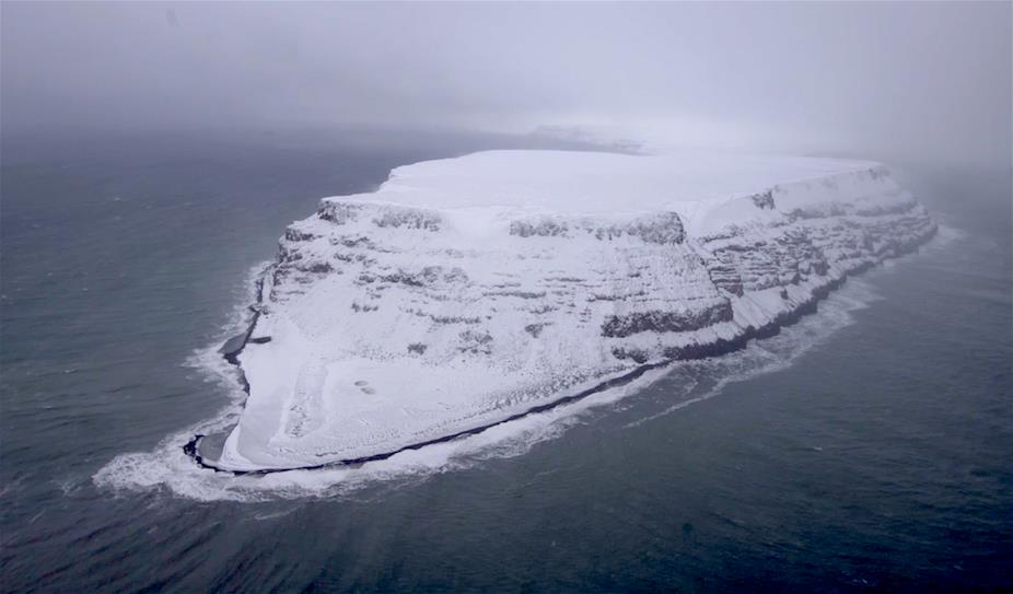 This section of    Bennett Island   , one of the    De Long islands    in the    East Siberian Sea   , looks like an half-sunk ocean liner