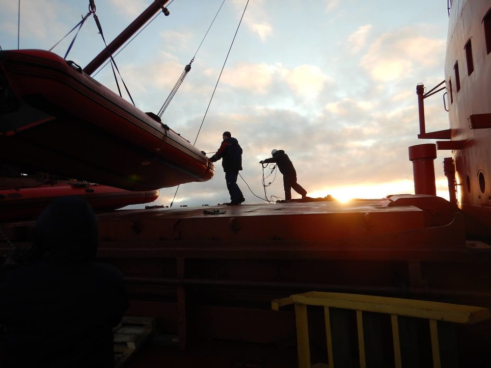 Unloading the rubber boats from our mother ship    SOMOV   , to execute a final open dive in the    East Siberian Sea