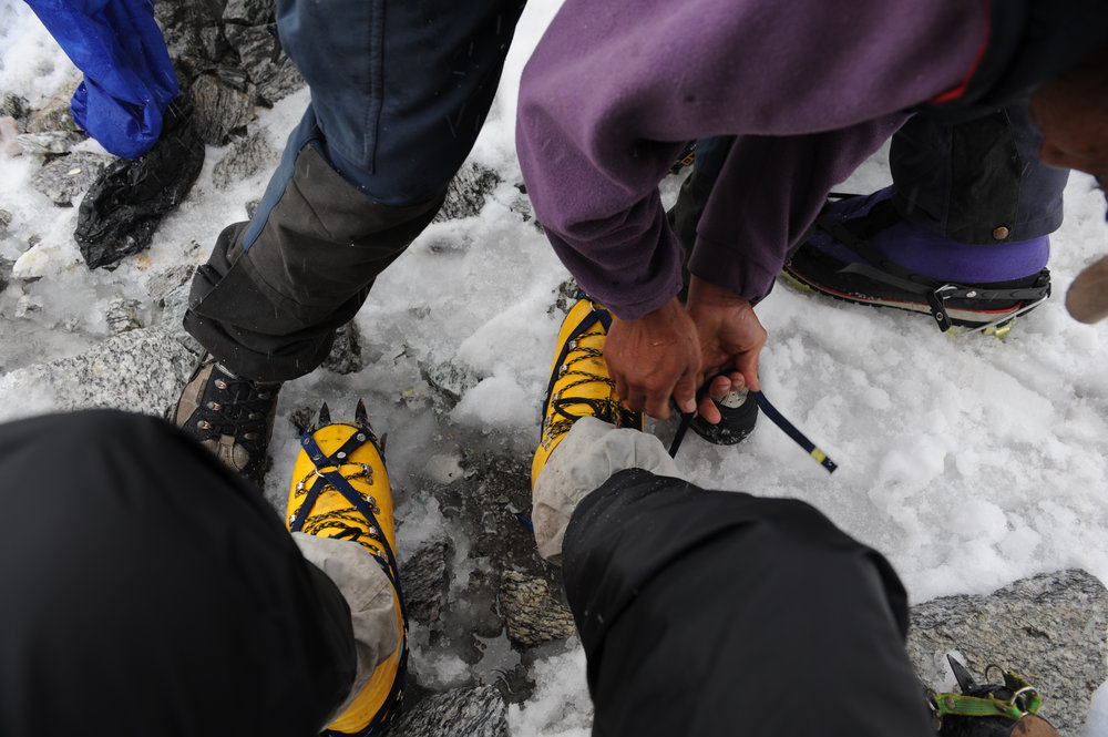 Fitting crampons.