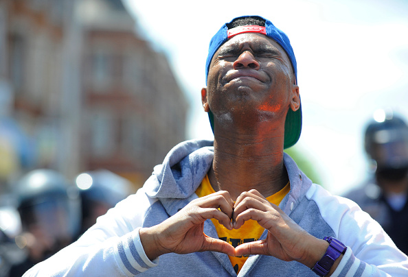 wolfspirals :     Devante Hill makes a heart with his hands after he was hit with pepper spray by police on Tuesday, April 28, 2015, in Baltimore, MD