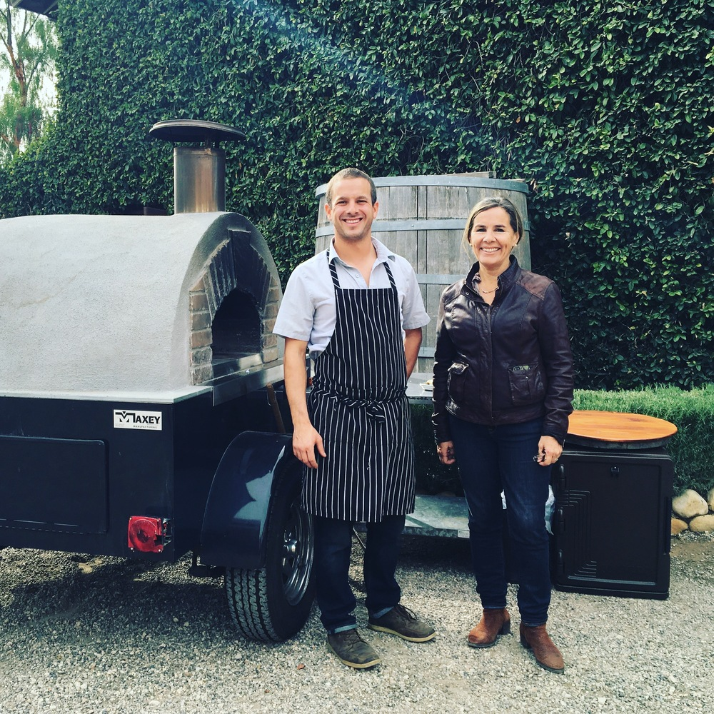 Tomás and Malena with our mobile Wood-Fired oven at Brander Vineyard in Los Olivos.