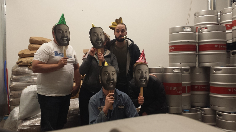 The crew wearing Reno masks in celebration of Reno's birthday.