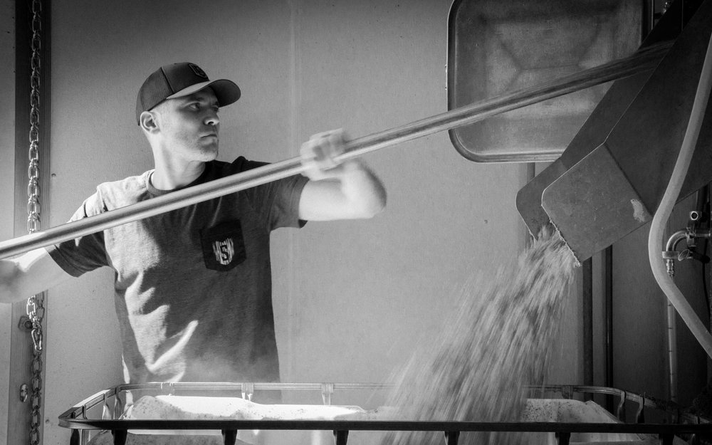 Aaron Stinner, cleaning the mash tun