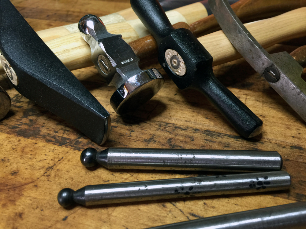 A variety of hammers and daps.
