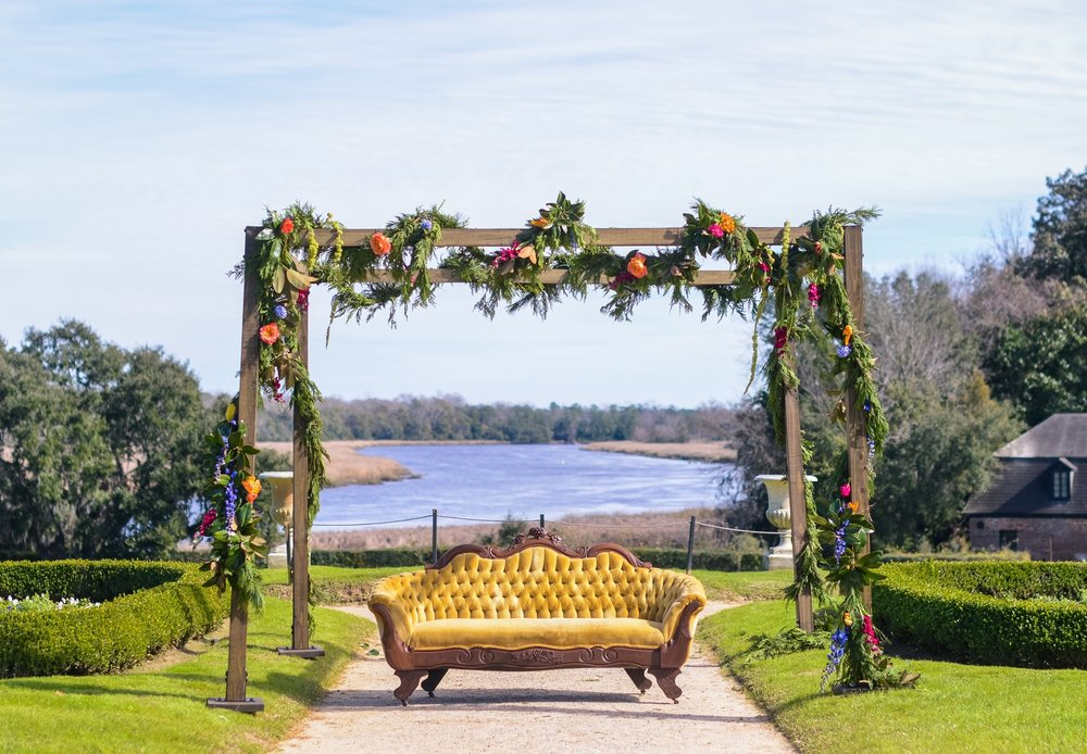 Featured Frenchie Rentals: Rustic Wood Mandap + Eleanora Tufted Velvet Sofa , Florals: The Flower Cottage