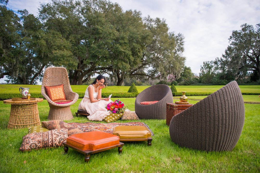 Featured Frenchie Rentals: Zara Rattan Chairs, Rattan Oblong Table, Rattan High Back Chair, Hubert Persian Rug, Indian Stool Trio, Assorted Pillows + Decor