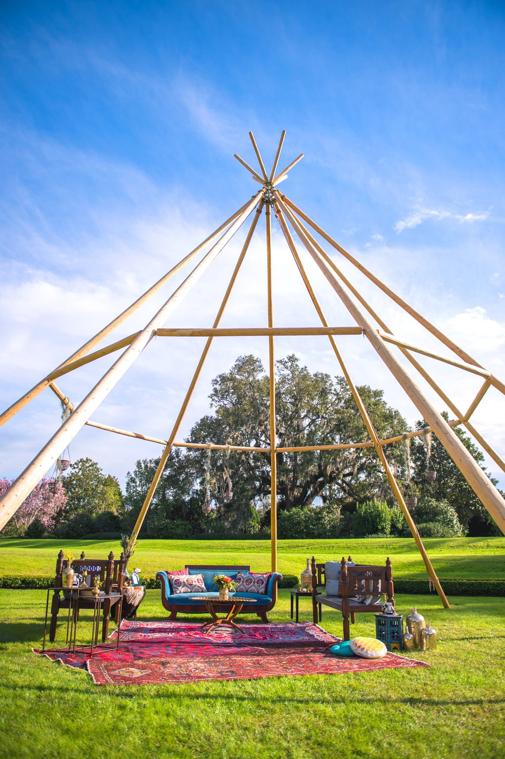 Featured Frenchie Rentals : Indigo Velvet Sofa, Farah Moroccan Benches, African Drum Table, Moroccan Brass Tray Table, Nesting Indian Side Tables, Assorted Persian Rugs, Assorted Pillows + Decor  Tipi Rental: Indah Events