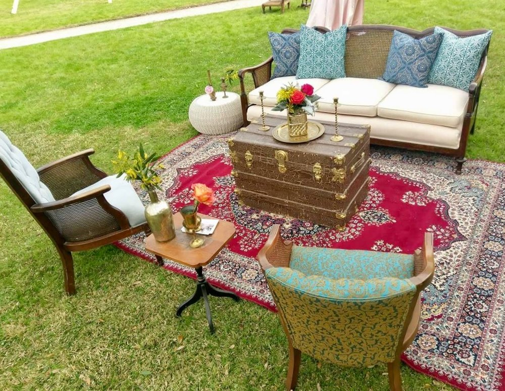 Featured Frenchie Rentals: Gabrielle Cane Back Sofa, Delilah Velvet Chair, Adalie Arm Chair, Sailor Vintage Trunk, Harbin Rattan Table, Percy Turkish Rug, Assorted Brass Decor, Assorted Pillows