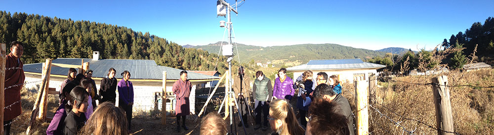 The weather station in Bumthang, Bhutan with Changa Tsering, HEROES project coordinator, and the local environmental club.