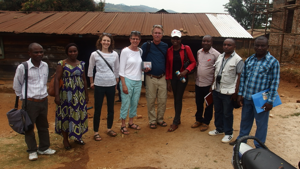 Amy stands outside one of LAV's rural training centers with fellow members of Mwendo Congo and LAV staff during august 2015 visit.