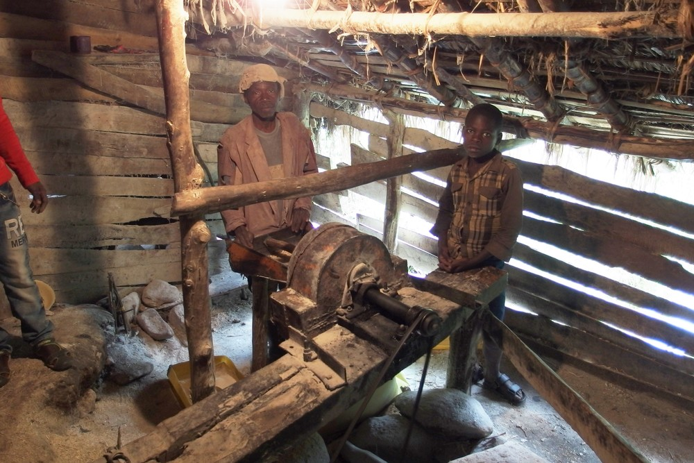 People grinding corn into flour at one of the two hydro-powered mills.