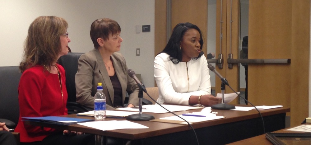 Dr. Edwige Mubonzi testifying with Dr. Ellen Kennedy (far left) and Senator Sandra Pappas (Middle)