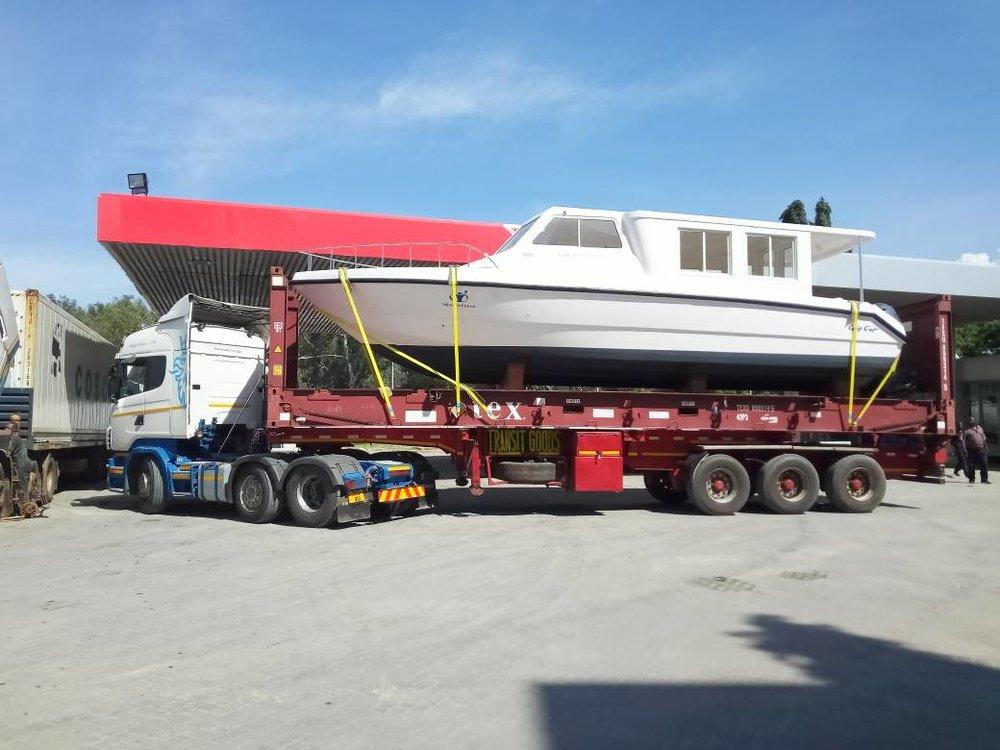 boat on truck 1.JPG