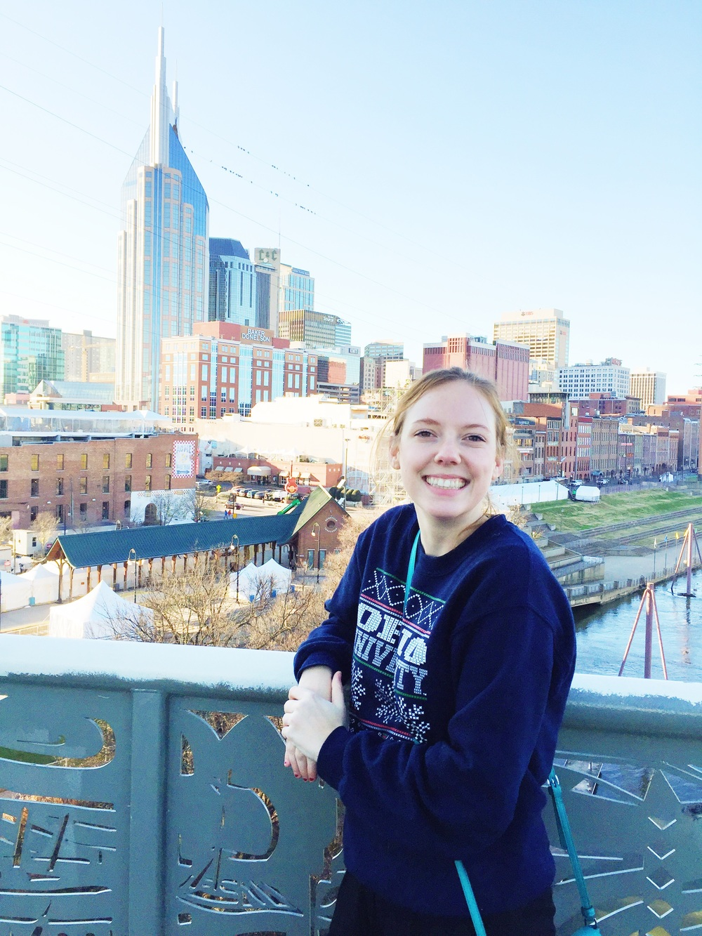 Amanda on the Pedestrian Bridge with a view of downtown.