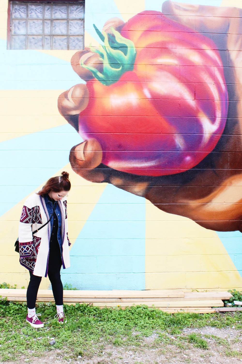 Whitney in front of a nearby mural.