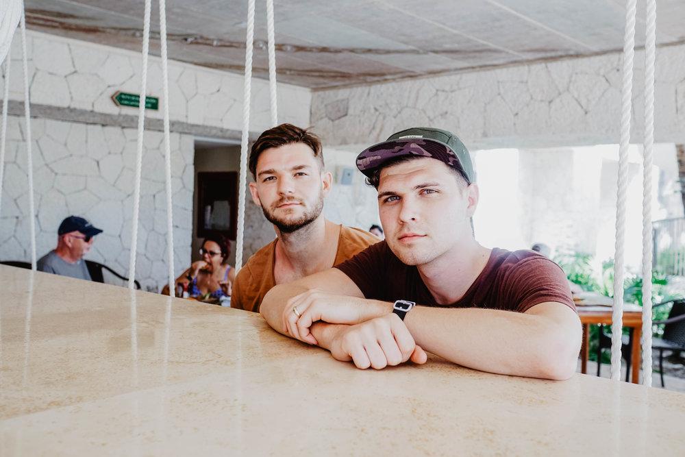 Two men at sitting at the bar at Hotel Xcaret Mexico