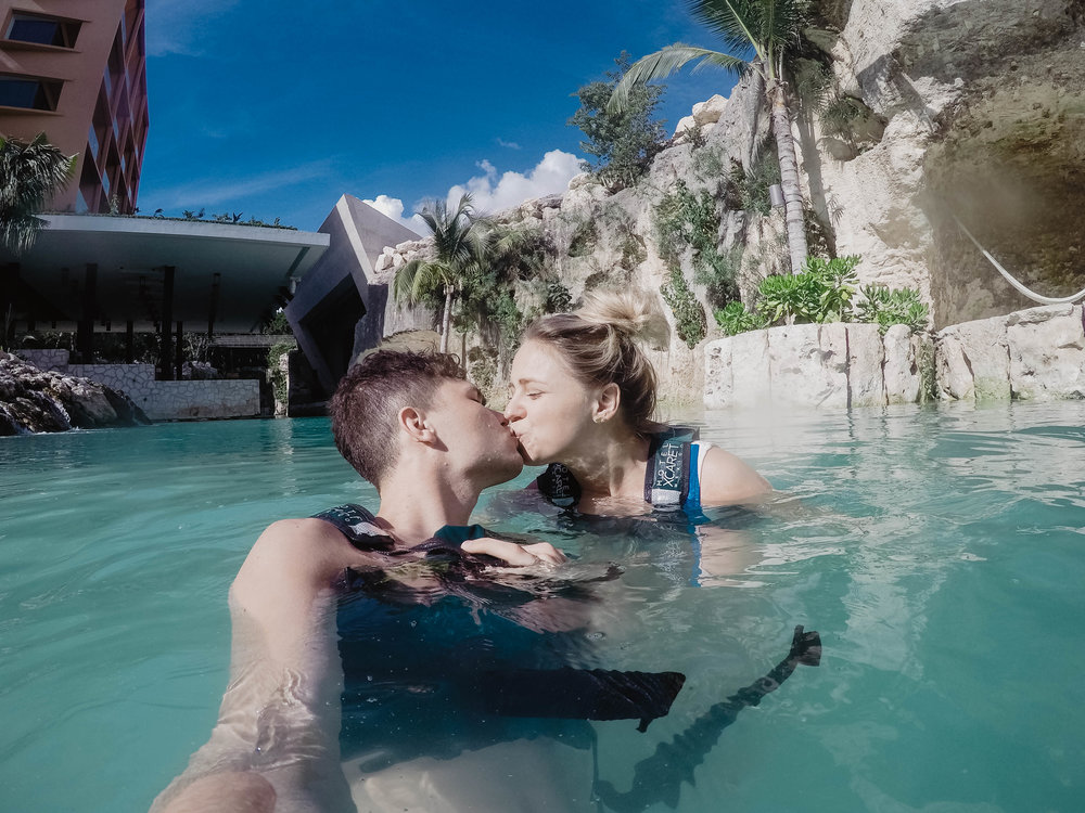 Posing for a kissing photo in the lazy river at Hotel Xcaret Mexico
