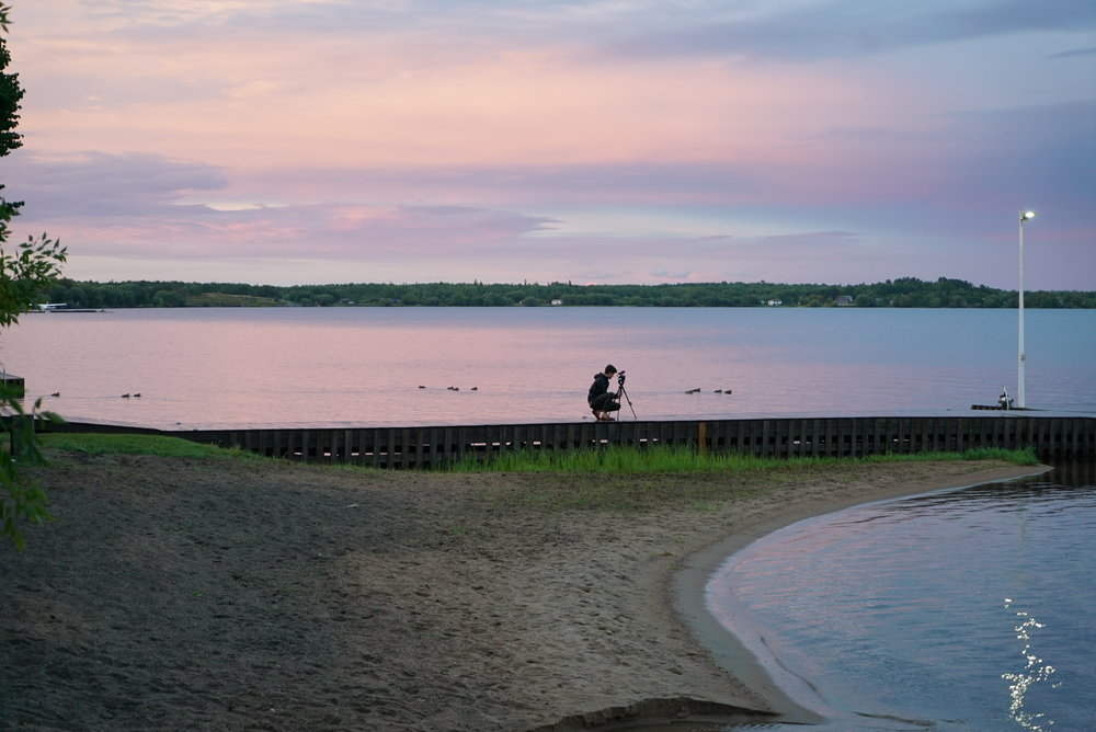 Filming a time-lapse on the dock during Kevin and Eli's wedding at La Place Rendez-Vous in Fort Francis Ontario.