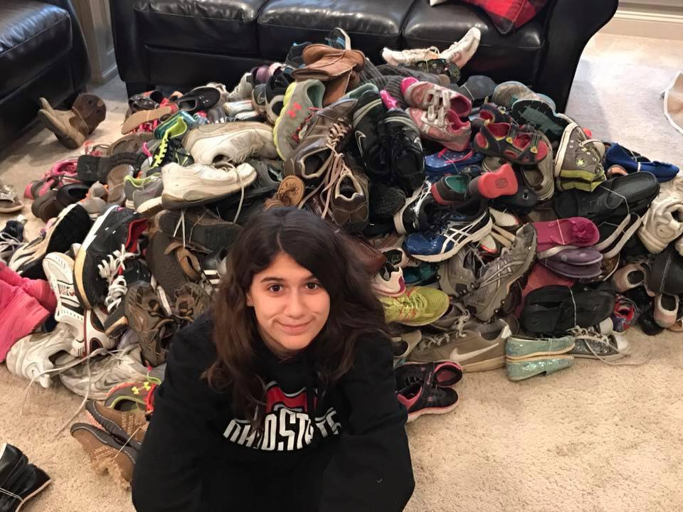 Service Project Leader, Sydney Fendler leads the charge collecting more than 300 pairs of shoes for Shoeman water project to ensure clean water in developing nations.