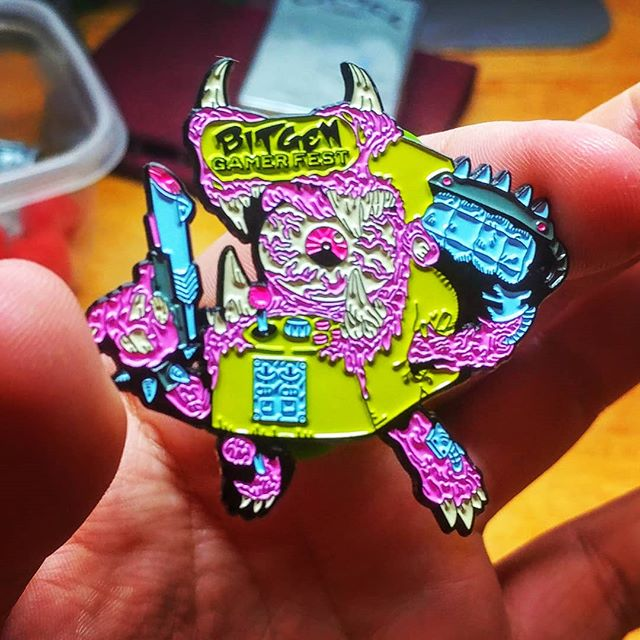 Its like birthing a new member of the family. Little cabby the #bitgengamerfestxiii mascot has gotten transformed into a #limitededition numbered and signed #diecut #enamelpin !!! Thanks to the spot on work from my patnahs @phatpins who did what no one else could. Seriuosly, I looked around for a pin maker that could do this pin with a signature and have em numbered and its tough.  #bitgengamerfest #ghostbatart