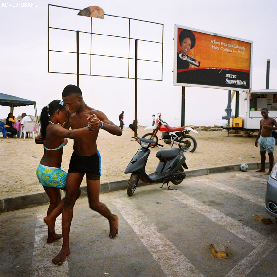 thesoulfunkybrother :     -   A young couple dance on a street by the beach . Luanda, Angola. '10   ph. Alfredo A.