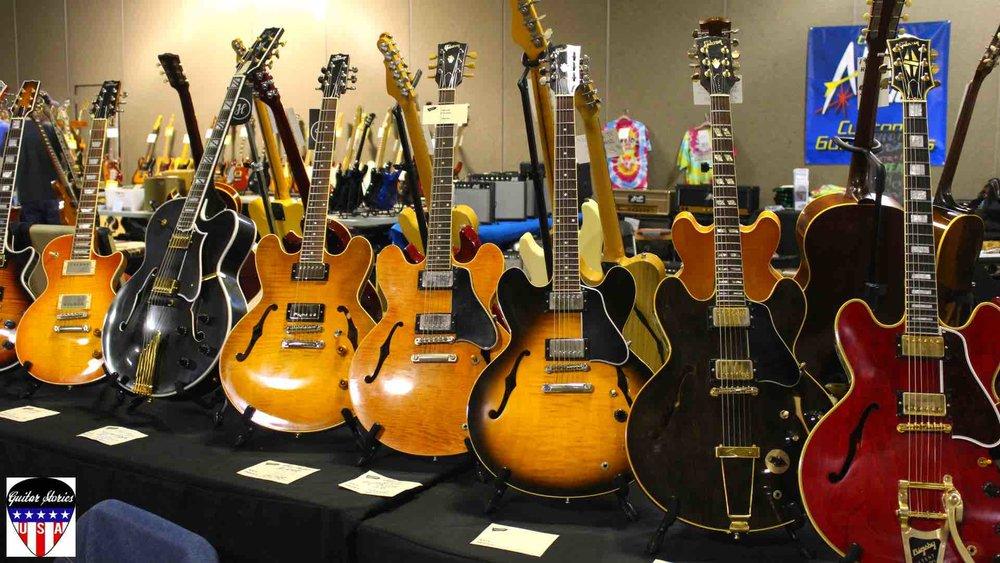 Gibson ES-335s at Guitar Show.jpg