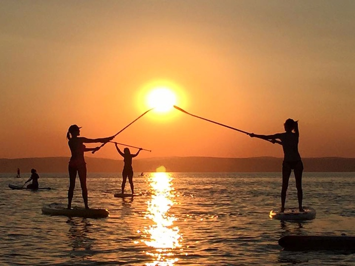 Sunset supyoga on Lake balaton. the perfect way to end a hot summers day.                                                     Photo credit: Balázs Mészáros