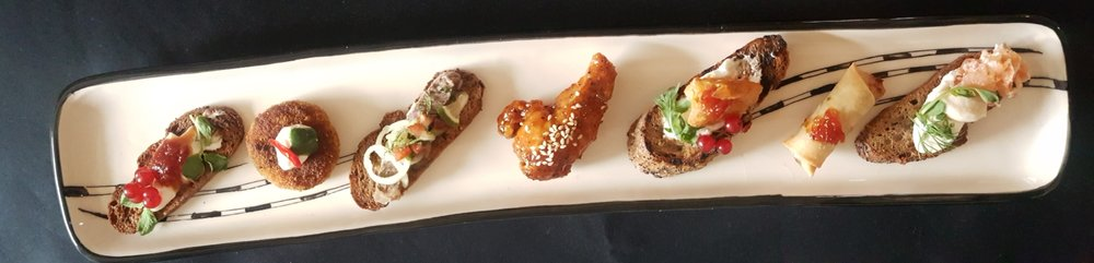 CROSTINI CREAM CHEESE & CHILLI JAM // LAMB POTATO CAKE WITH YOGHURT & MINT CHUTNEY // CROSTINI WITH ROAST BEEF & CACHUMBA // SRIRACHA CHICKEN WING // SPICY PRAWN WITH YOGHURT & RED CURRENT ON BRUSCHETTA // VEGETABLE SPRING ROLL // SMOKED SALMON & CREAM CHEESE CROSTINI