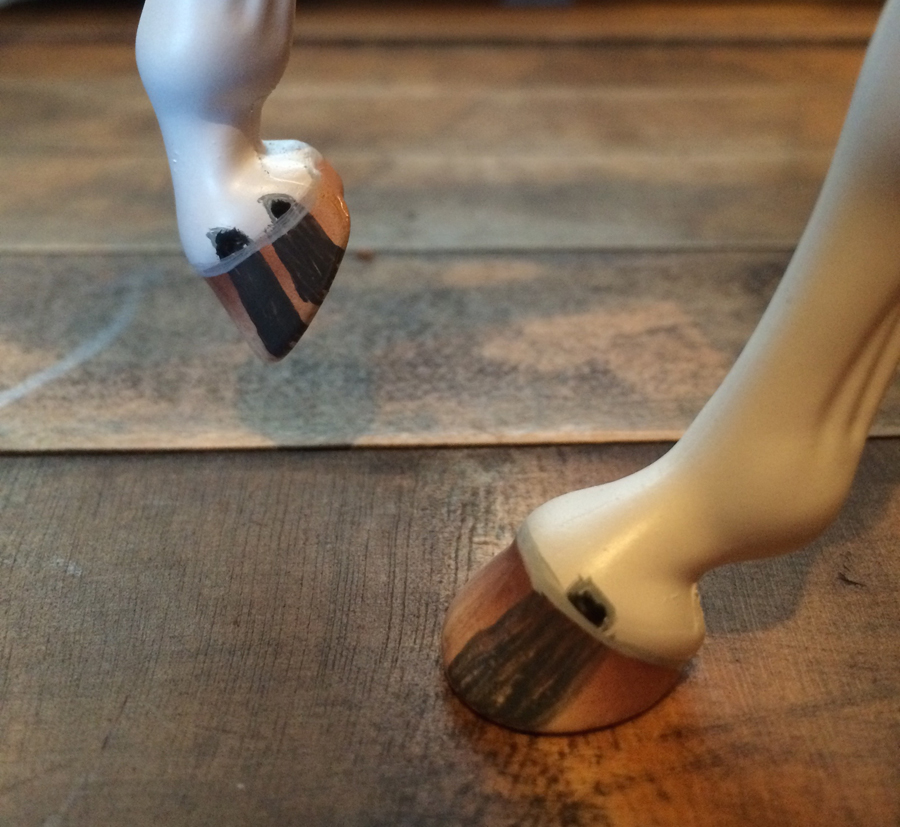 A closeup of the hooves on a Marble Model