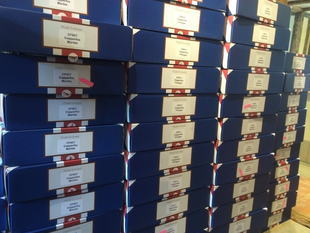 A Wall of Red, White and Blue Copperfox Boxes ready for despatch. The fox stickers seal the boxes so we know that model has been checked and everything is ready to go. The pink stickers are to tell us whether it's a domestic or international order. We try to be organised!! ;-)
