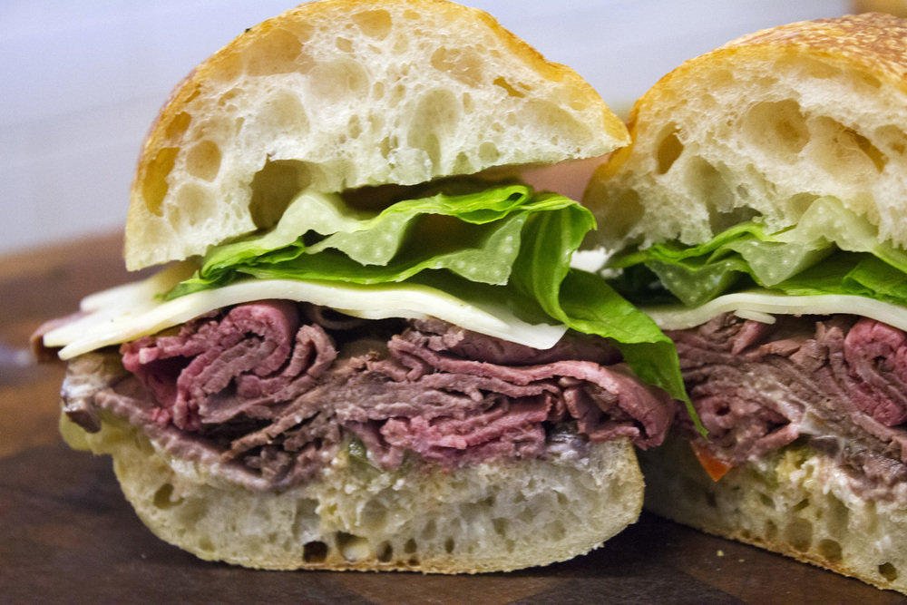 Roast Beef  Savenor's roast beef, peppers + onions, cheddar & horseradish aioli on ciabatta