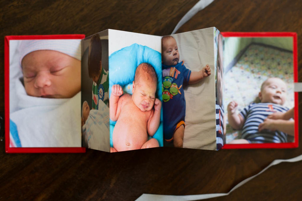 Newborn photographer and birth doula, Christina Hodgen, offers Atlanta families a professionally printed keepsake of the first days after birth.