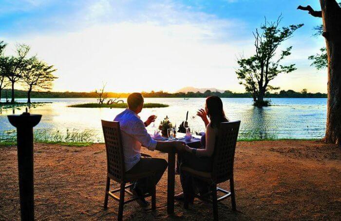 Honeymoon-couple-dining-in-a-jungle-lodge.jpg